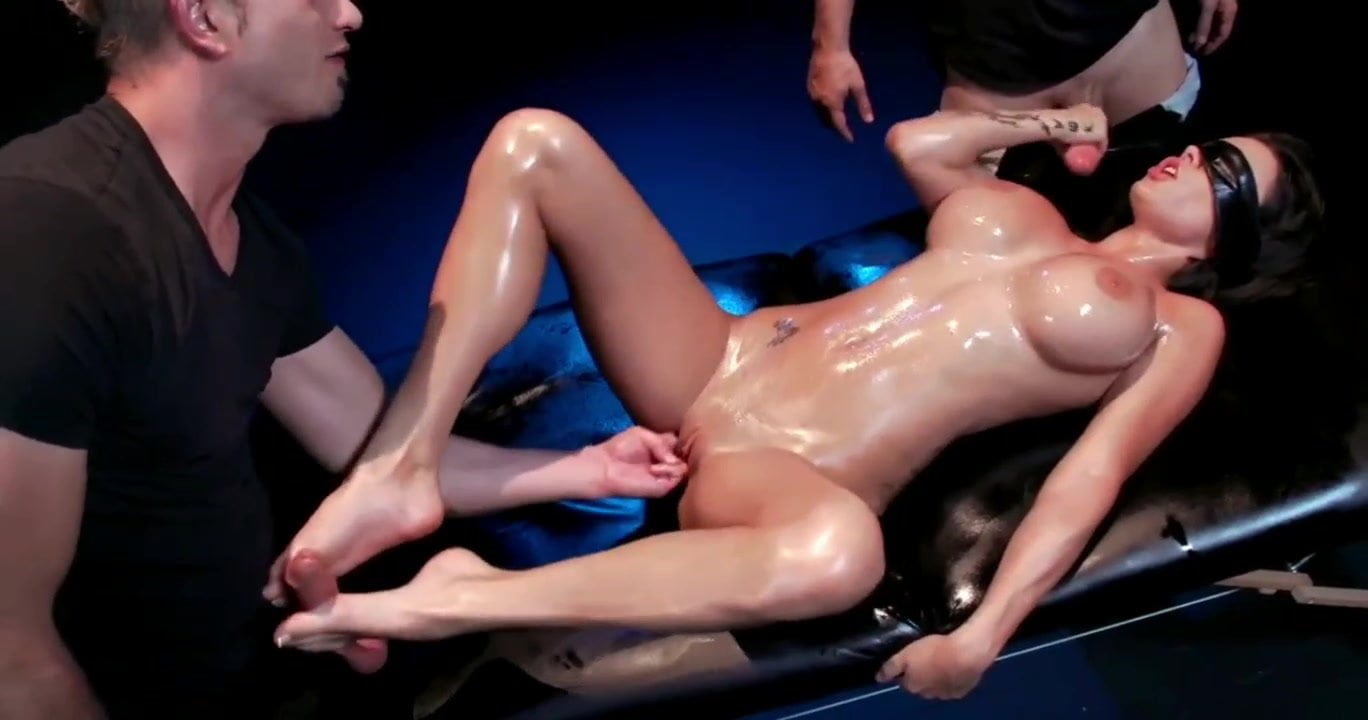 Beautiful  girl with huge fake tits is blindfolded and stripped. Next she gets an oil massage and a threesome (foot job, handjob, fingering, blowjob, doggy style, BDSM, cum in mouth)
